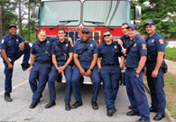 CFD Firefighters stand in front of fire truck