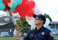 CFD Firefighter holds Special Olympics torch