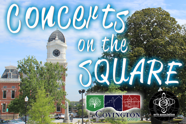 Covington Courthouse with glowing blue text Concerts on the Square
