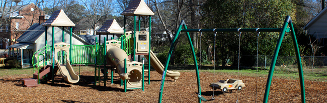 Green and beige playground equipment