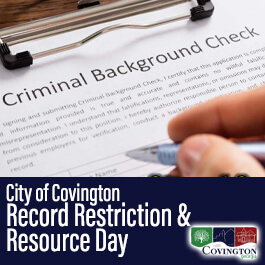 Hand holding pen to sign Criminal Background Check