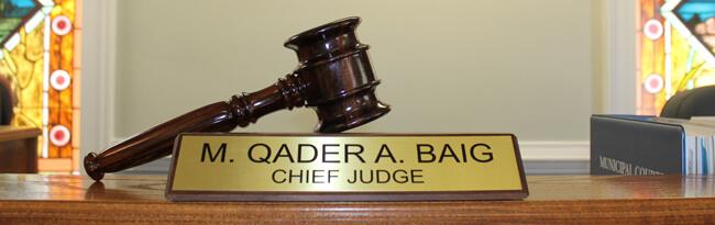 Municipal Court Judge Qader Baig nameplate and gavel