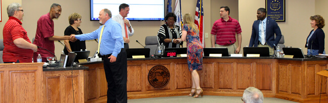 City Council shaking Finance Director and Assistant Finance Director's hands