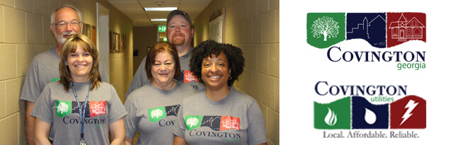 Five city employees wearing city logo t-shirts
